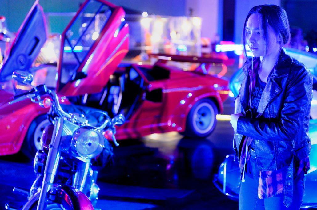 Woman staring at motorcycle